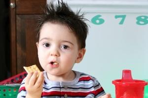 Adorable Preschooler Eating Crackers
